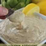 Lemony Artichoke and White Bean Hummus Recipe. I love this clean eating dip appetizer. Sometimes I will eat it as an main dish when I dont feel like cooking- even my kids love this. Great for parties, potlucks or game day.